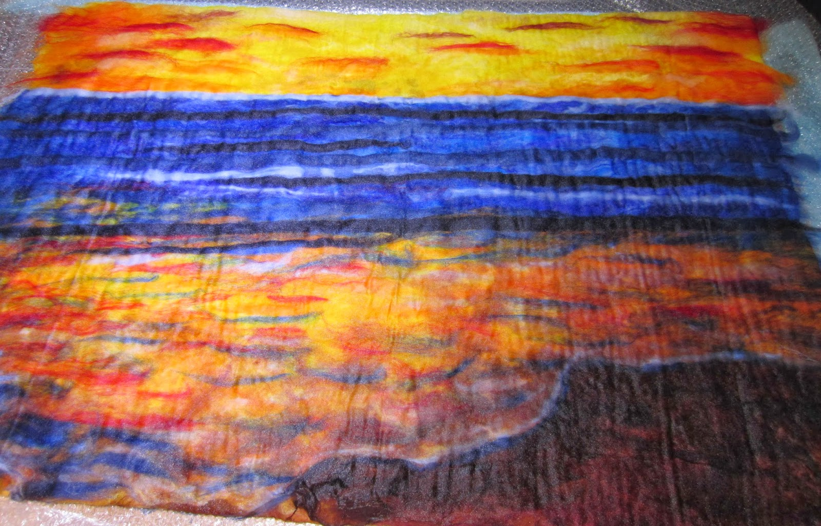 The beach wet felting teri berry i have laid out all the top for wet felting im afraid i forgot to take a picture before wetting out but here it is before adding the silhouettes baditri Images